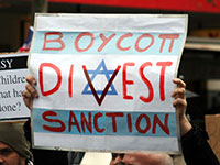 Boycott-Plakat bei einer Demonstration der umstrittenen BDS-Kampagne in Melbourne, 2010 (Photo: Takver | CC BY-SA 2.0 via Wikipedia, https://bit.ly/2Ir51QX)