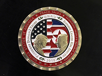 A commemorative coin for the upcoming U.S. and North Korean meeting (Photo: Kevin Dietsch/UPI Photo via Newscom picture alliance)