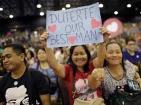 Eine Unterstützerin des philippinischen Präsidenten Rodrigo Duterte | © picture alliance/AP Photo