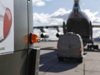 Military trucks load medical supplies onto an Il-76 cargo plane in Russia (Photo: Alexei Yereshko, Russian Defense Ministry Press Service via AP)